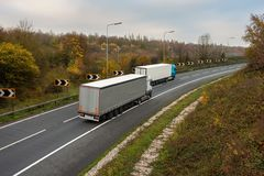 Articulated lorries on the road. Road transport. Articulated lorries in motion on the road royalty free stock photography