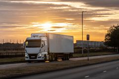 Road transport, Lorry on the road. Articulated lorry in motion on the road during beautiful sunset stock image