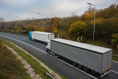 Articulated lorry. Road transport. Articulated lorry in motion on the road royalty free stock photos