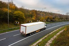 Articulated lorry on the road. Road transport. Articulated lorry in motion on the road stock photo