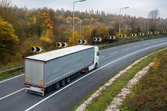 Articulated lorry on the road. Road transport. Articulated lorry in motion on the road stock image