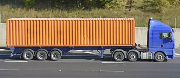Articulated lorry and trailer loaded with a container Royalty Free Stock Photos