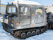 Articulated military tracked cargo vehicle on snow Royalty Free Stock Photo
