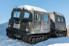 Articulated military tracked cargo vehicle on snow Stock Photos