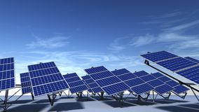 Articulated solar panels with blue sky in morning. Field of articulated solar panels with morning light and a blue sky with some cirrus clouds Stock Photography