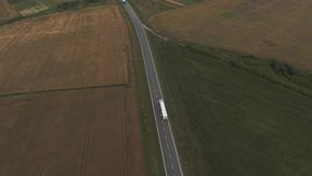 Articulated Truck Road Goes through Fields. Aerial Video stock footage