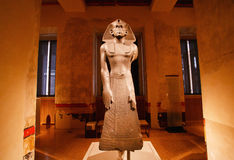 Artifact sculpture of egyptian king in space of museum Royalty Free Stock Photography