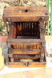Artifact of wine making. Old and dusty artifact for pressing the grapes and make wine Stock Photo