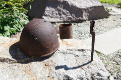 Artifacts war helmet. VOLGOGRAD, RUSSIA - July 06, 2016: A monument rusty military a helmet, a bayonet, sleeves from weapon. Museum panorama Mamayev Kurgan stock photography