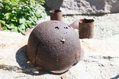 Artifacts war helmet. VOLGOGRAD, RUSSIA - July 06, 2016: A monument rusty military a helmet, a bayonet, sleeves from weapon. Museum panorama Mamayev Kurgan stock images