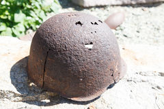 Artifacts war helmet. VOLGOGRAD, RUSSIA - July 06, 2016: A monument rusty military a helmet, a bayonet, sleeves from weapon. Museum panorama Mamayev Kurgan stock photos