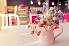 Artificail flower in vintage style coffee shop Stock Photo
