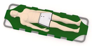 Artifical character on green stretcher Stock Photos