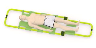 Artifical character on stretcher - dead or injured Stock Images