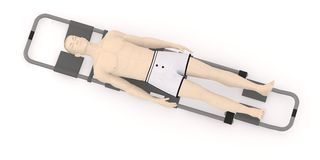 Artifical character on stretcher - ill Stock Image