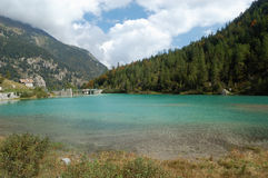 Artificial alpine lake Stock Images