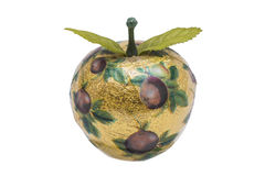 Artificial apple made of wood with gold paper and pattern Stock Images