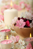 Artificial aromatic SPA flowers and candles royalty free stock photo