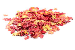 Artificial autumn leaves on a pile Stock Photos