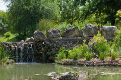 Artificial backwater with a small waterfall Royalty Free Stock Photo