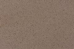 Artificial beige stone dust sparkle texture for background. Close up of artificial beige stone dust sparkle texture for background. High resolution photo royalty free stock photo