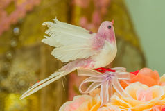 Artificial birds on flowers Stock Photo
