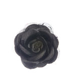 Artificial black flower isolated on white Royalty Free Stock Photo