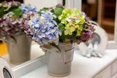 Artificial bouquet flowers blue-yellow-green colors stock photo