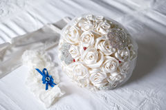 Artificial bouquet, garter and gloves - bride accessories Stock Image