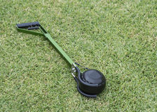 Artificial Bowling Arm on Green Grass. Stock Images
