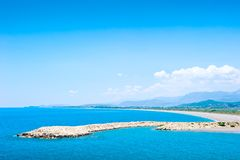 Artificial breakwater in shallow warm waters of the Mediterranean Sea. Stock Photos