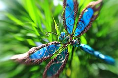 Artificial butterfly in a plant Stock Photo