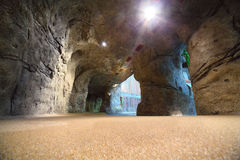 Artificial cave in waterpark with waterfall Royalty Free Stock Photos