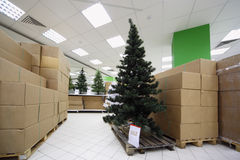 Artificial Christmas tree between carton boxes Royalty Free Stock Photography