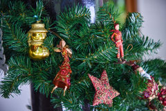 Artificial Christmas tree decorated with toys Royalty Free Stock Photography