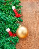 Artificial Christmas tree, electric candles and golden ball Stock Images
