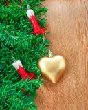 Artificial Christmas tree, electric candles and golden heart Royalty Free Stock Photo
