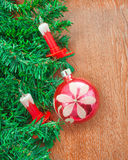 Artificial Christmas tree, electric candles and pink ball Stock Photos