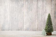 Free Artificial Christmas Tree On A Wooden Background. Royalty Free Stock Images - 63421639