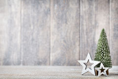 Artificial Christmas tree on a wooden background. Royalty Free Stock Photography