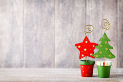 Artificial Christmas tree on a wooden background. Golg and green christmas tree on a wooden background Royalty Free Stock Image