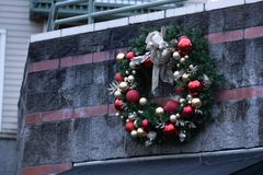 Artificial Christmas wreath on the building. Artificial Christmas wreath on the side of the building in downtown Portland, Oregon stock photos