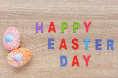 Artificial color eggs on wooden plank background. For Easter day Royalty Free Stock Photography