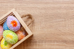Artificial color eggs on wooden plank background. For Easter day Royalty Free Stock Images