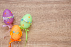 Artificial color eggs on wooden plank background. For Easter day Royalty Free Stock Image