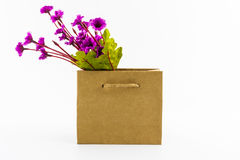 Artificial colorful of flowers made from cloth in shopping bag. Royalty Free Stock Images