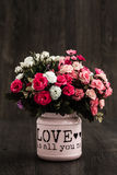 Artificial Colorful Flowers. In a pink flower vase stock images