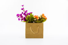 Artificial colorful of flowers in shopping bag. Royalty Free Stock Image