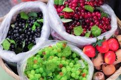 Artificial Colorful Grape Fruit. Colorful Mix Grape Fruit In A Basket Stock Photos