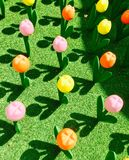 Artificial colorful tulip on green grass Stock Photo